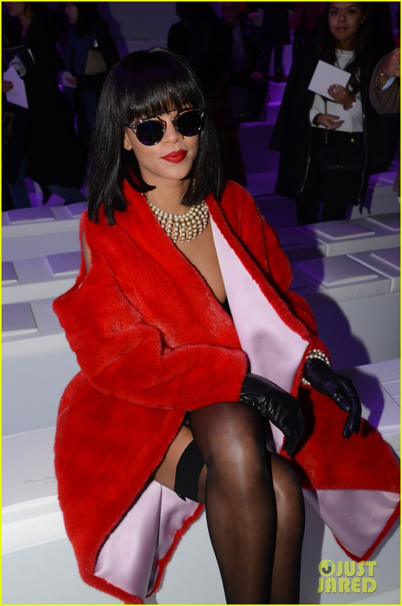rihanna covers up sexy black outfit with red coat 053062318
