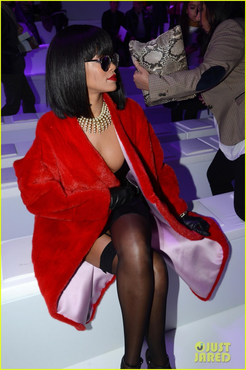 rihanna covers up sexy black outfit with red coat 063062319