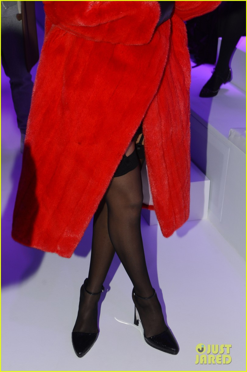 rihanna covers up sexy black outfit with red coat 083062321
