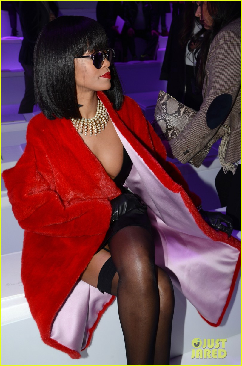 rihanna covers up sexy black outfit with red coat 093062322