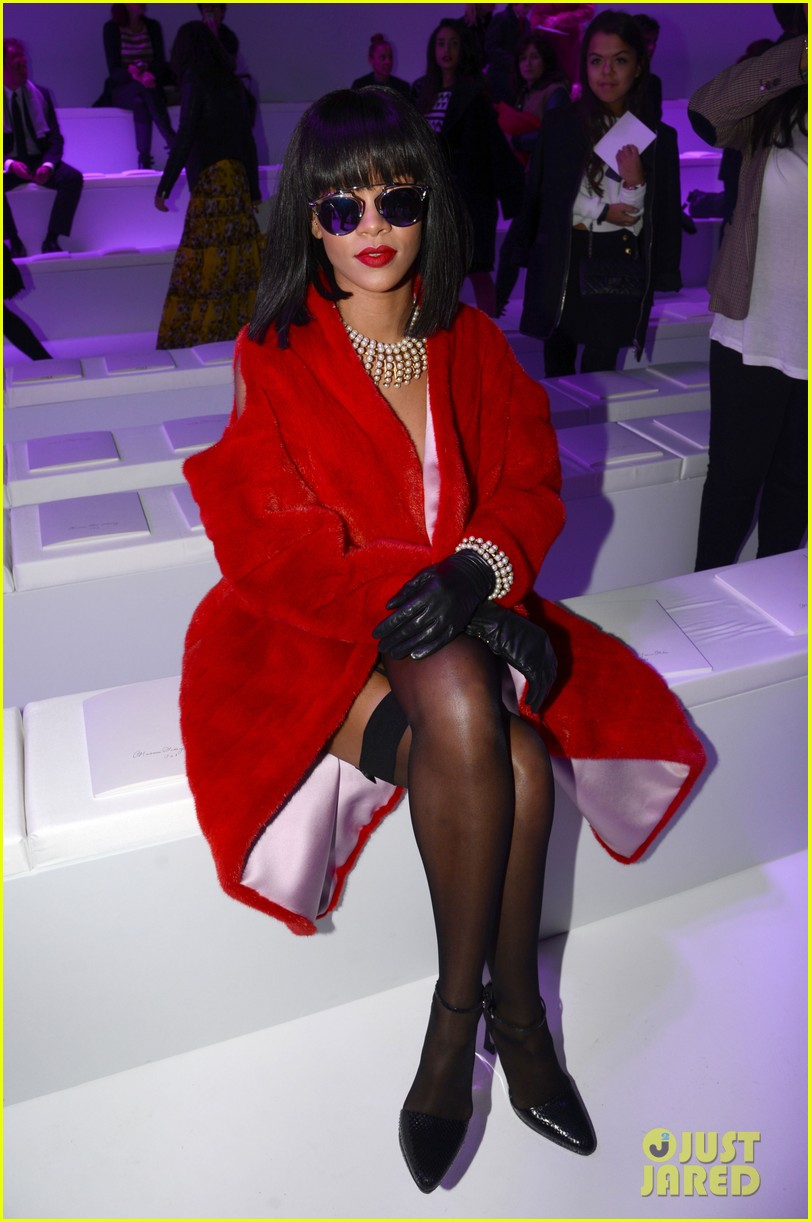 rihanna covers up sexy black outfit with red coat 123062325