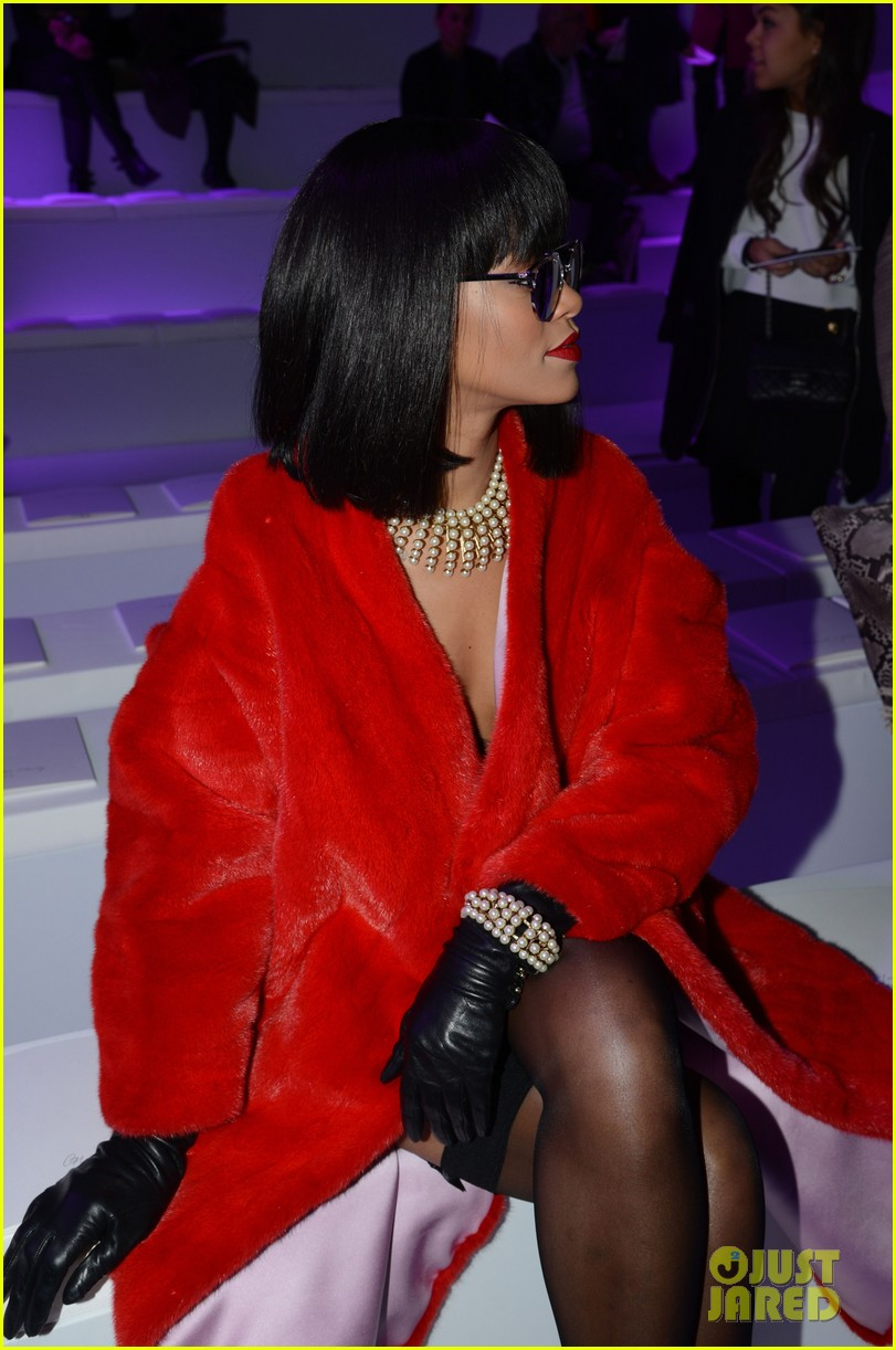 rihanna covers up sexy black outfit with red coat 133062326