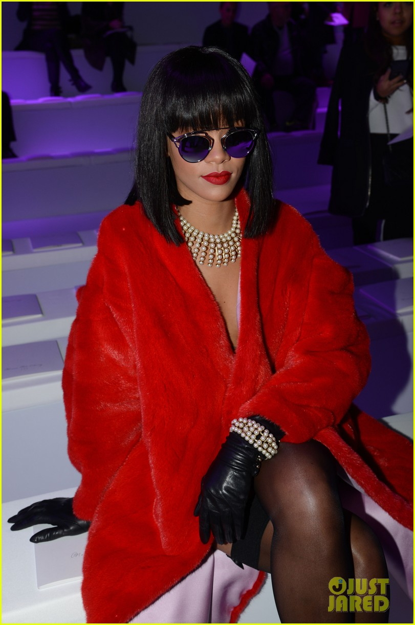 rihanna covers up sexy black outfit with red coat 143062327