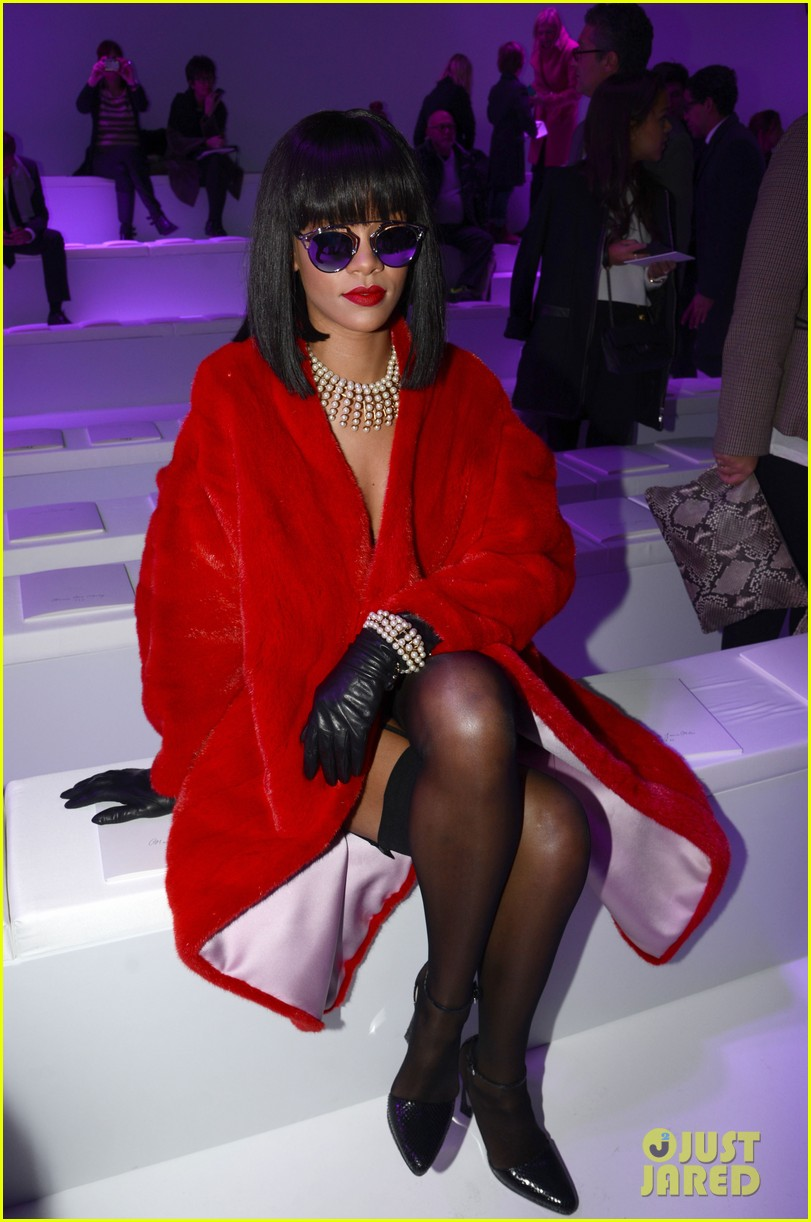 rihanna covers up sexy black outfit with red coat 15