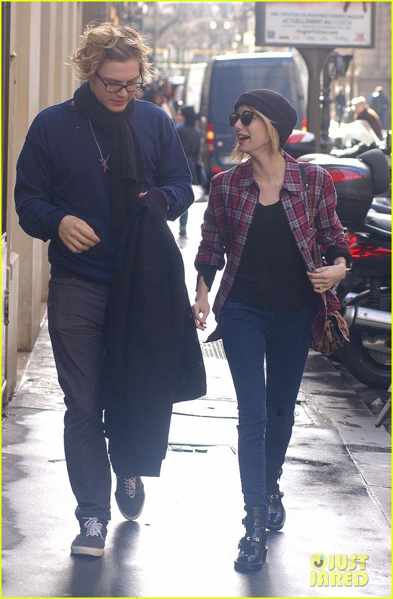 emma roberts evan peters skip oscars madness for paris fashion week fun 063061791