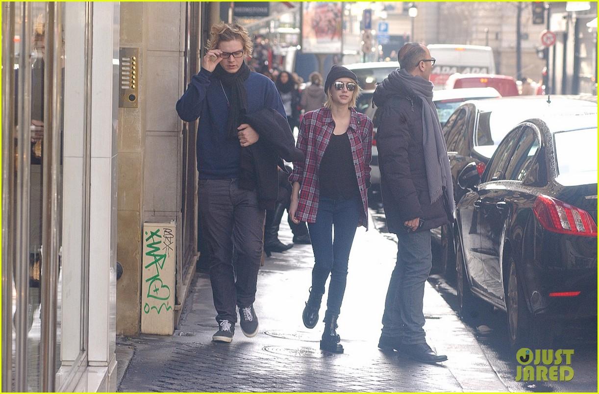 emma roberts evan peters skip oscars madness for paris fashion week fun 093061794