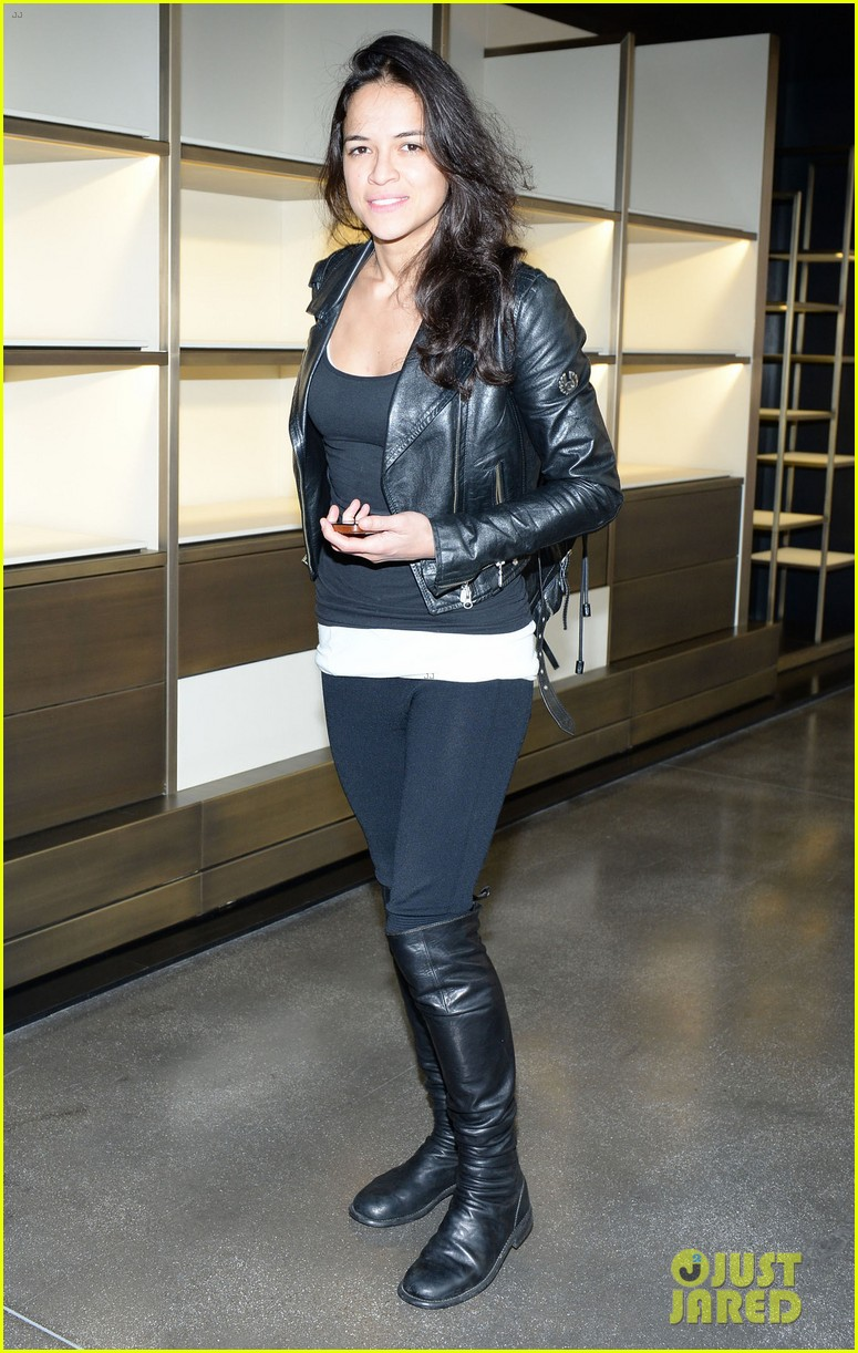 michelle rodriguez supports rumored girlfriend cara delevingne at fendi show 053057539