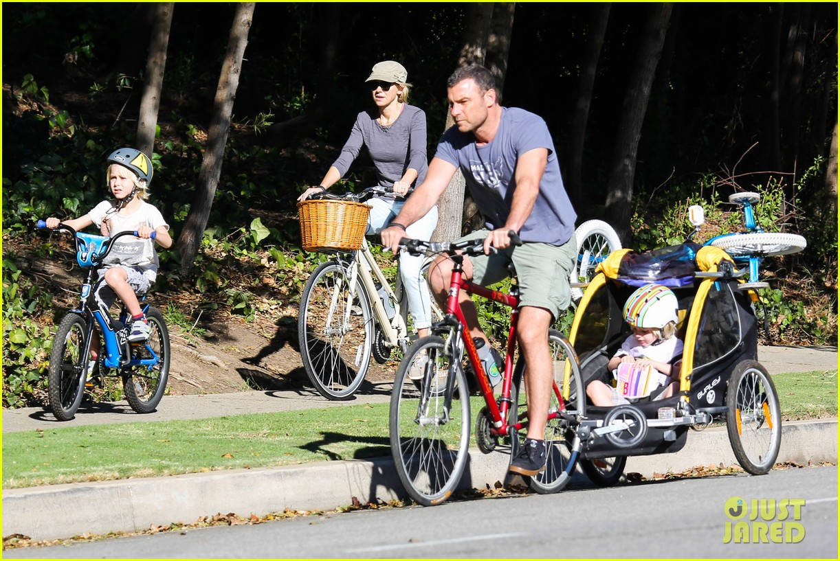 liev schreiber bares hot shirtless bod for family bike ride 163045875