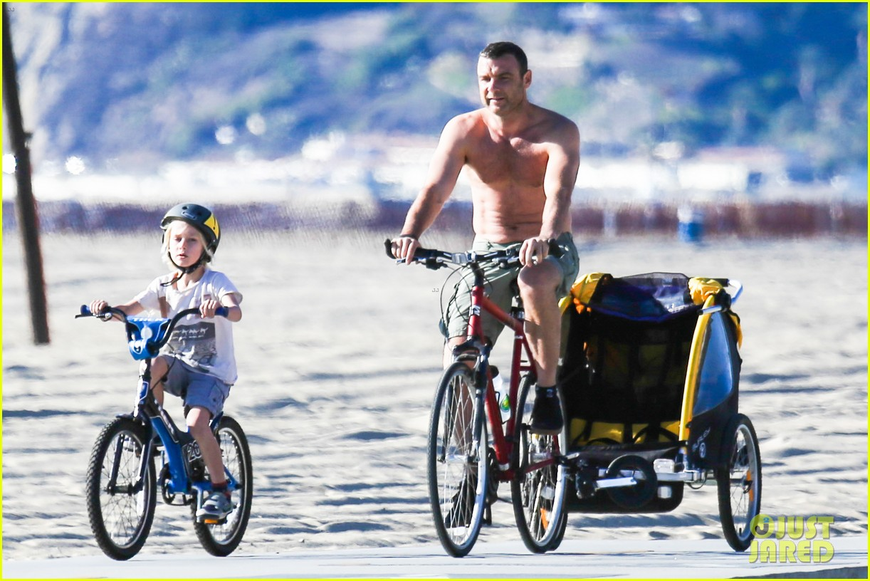 liev schreiber bares hot shirtless bod for family bike ride 173045876