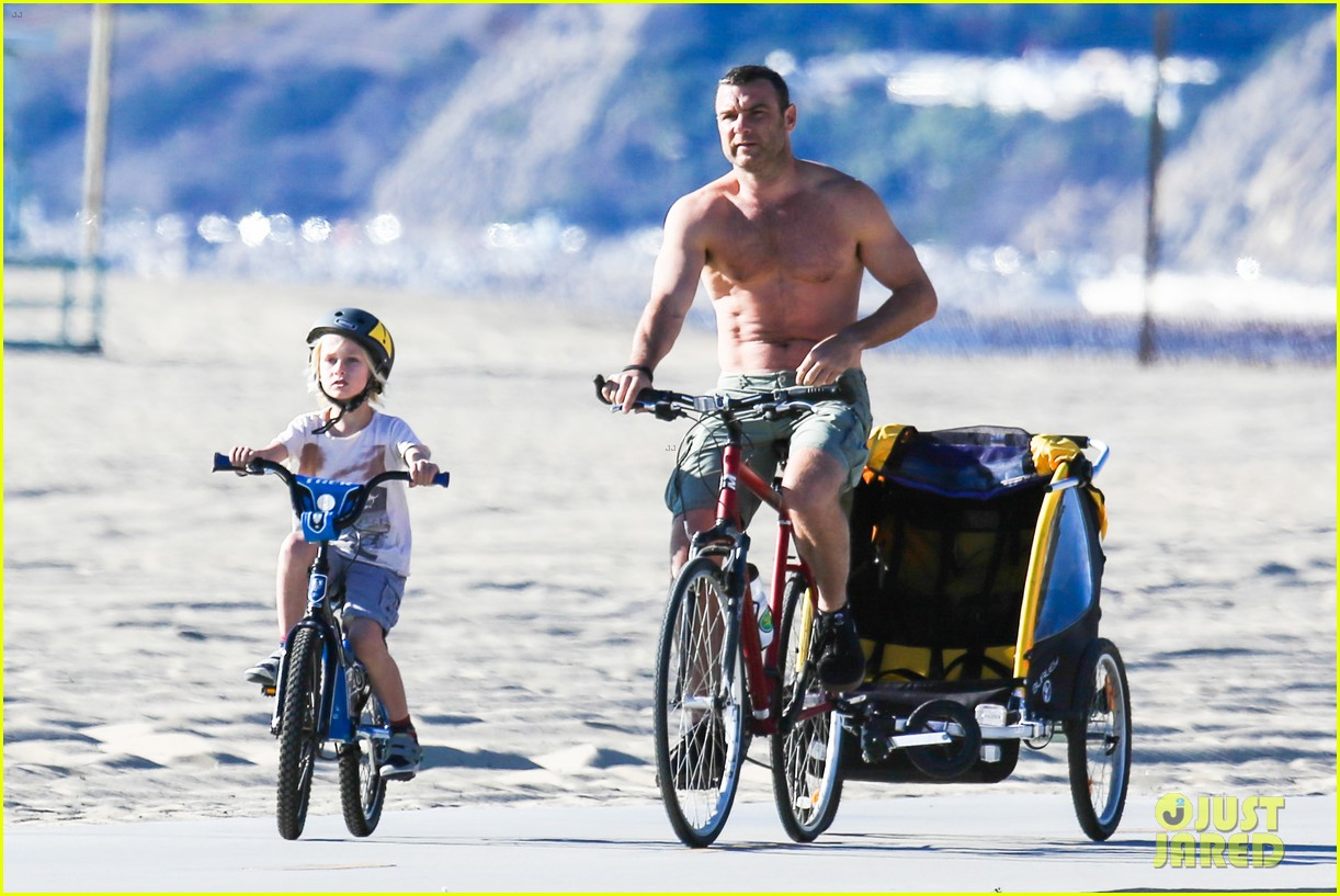 liev schreiber bares hot shirtless bod for family bike ride 193045878