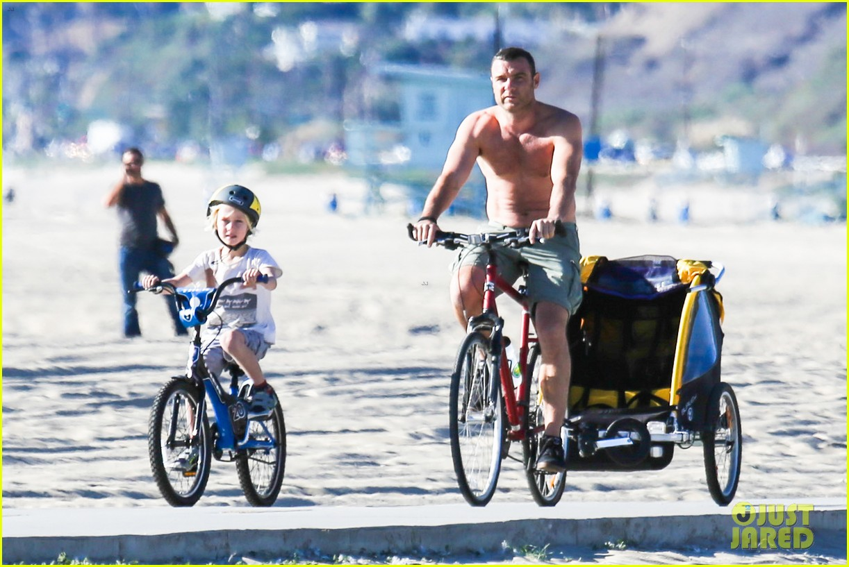 liev schreiber bares hot shirtless bod for family bike ride 24