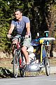 liev schreiber bares hot shirtless bod for family bike ride 18