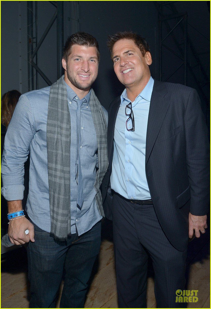 tim tebow eli manning football studs at directv super bowl party 043046324