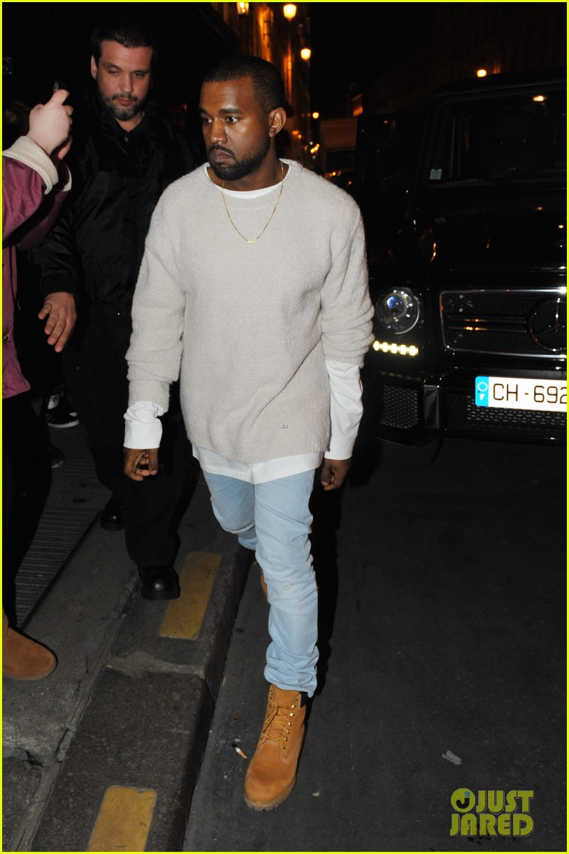 kanye west roams around paris while kendall jenner flies in 053061456