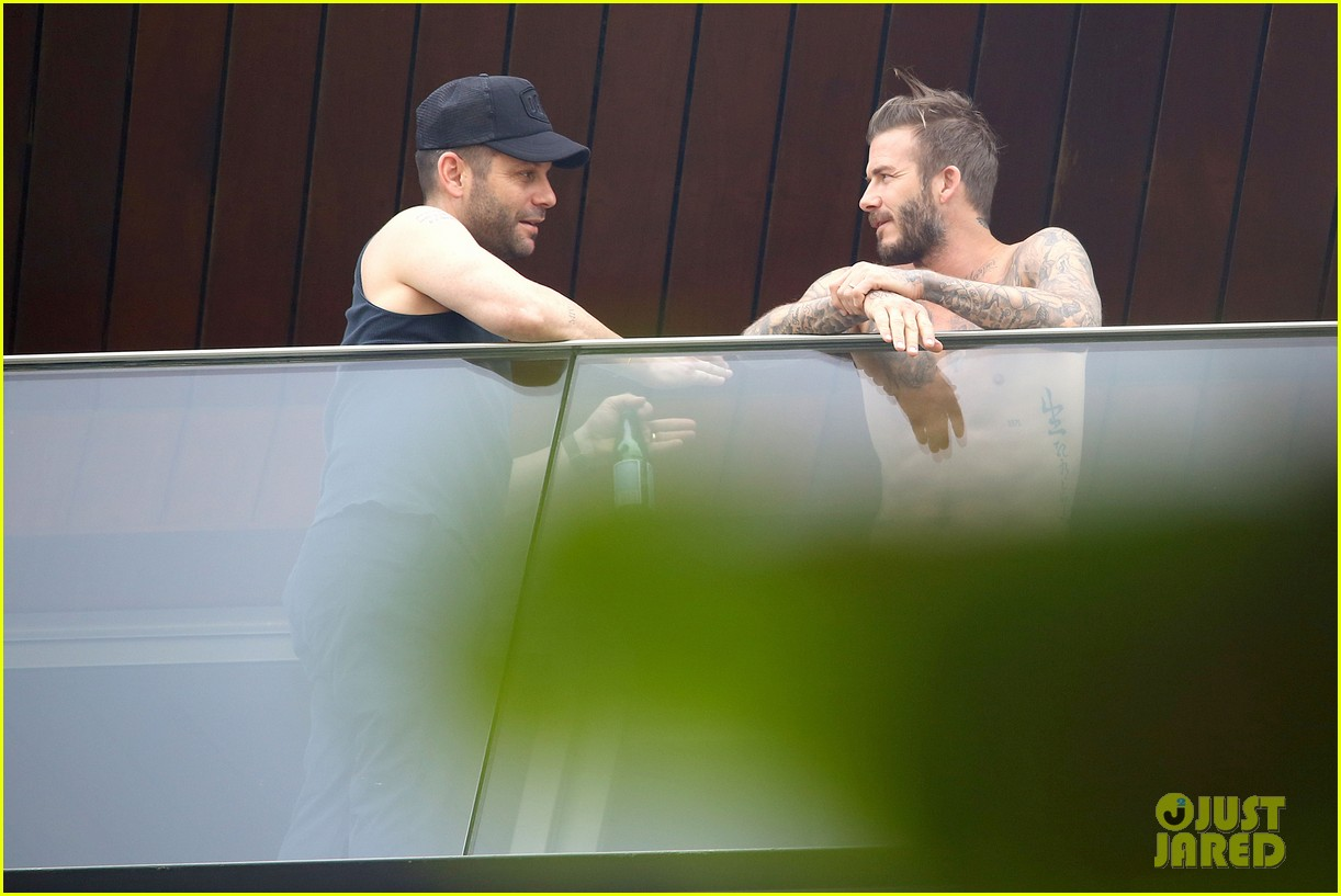 david beckham goes shirtless on his balcony in rio 203067327