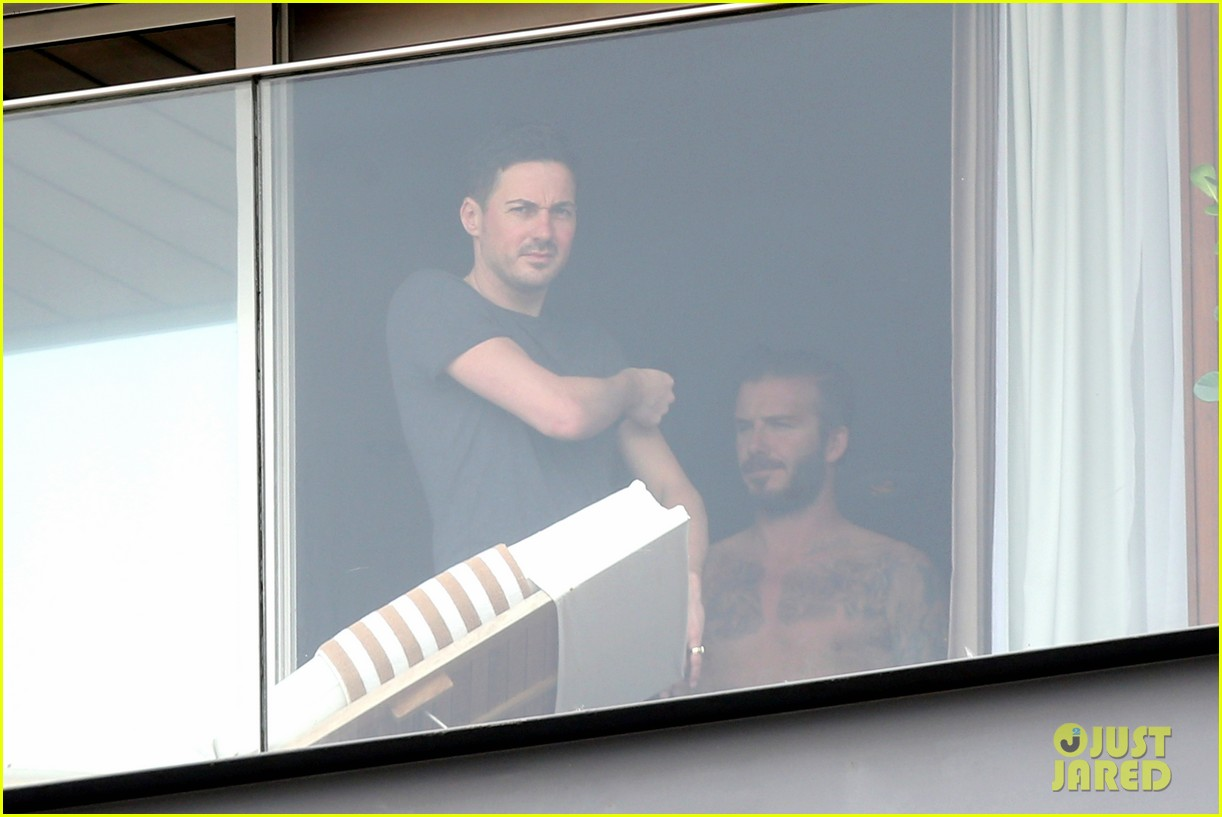 david beckham goes shirtless on his balcony in rio 213067328