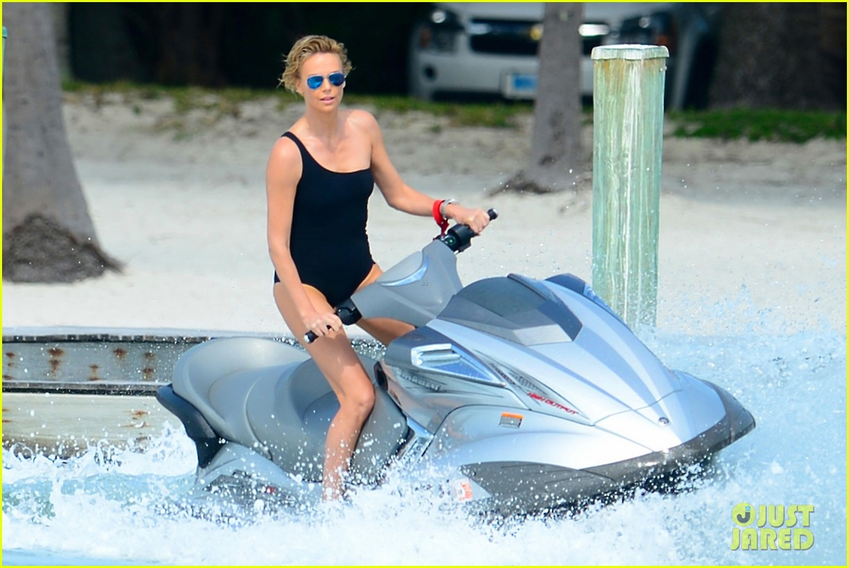 charlize therons bathing suit body is so enviable during jet ski shoot 013075466