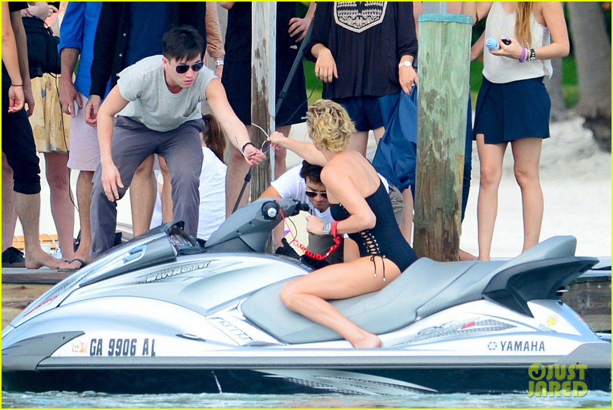charlize therons bathing suit body is so enviable during jet ski shoot 033075468