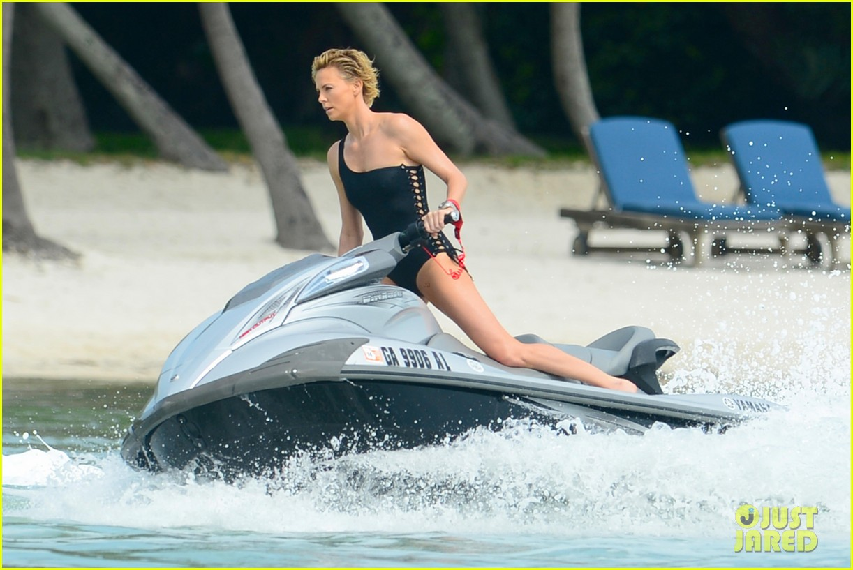 charlize therons bathing suit body is so enviable during jet ski shoot 043075469