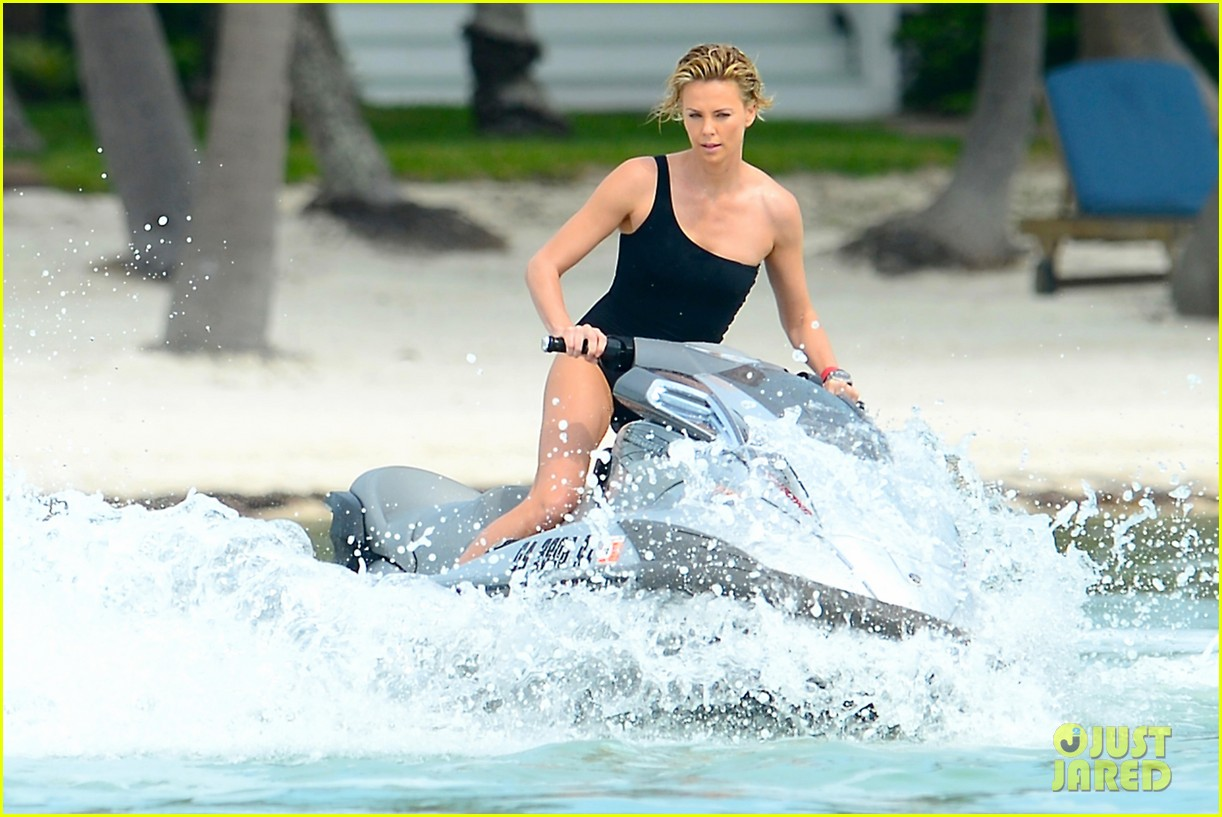 charlize therons bathing suit body is so enviable during jet ski shoot 06