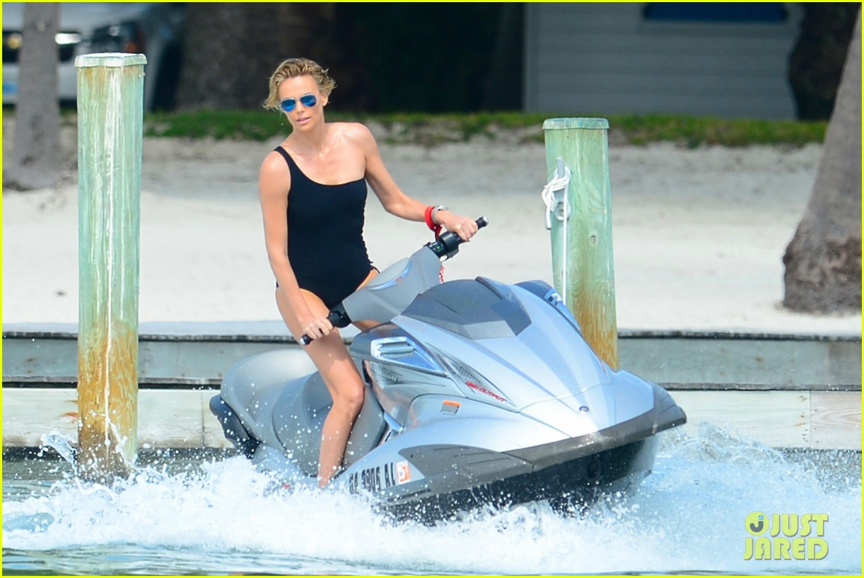 charlize therons bathing suit body is so enviable during jet ski shoot 07