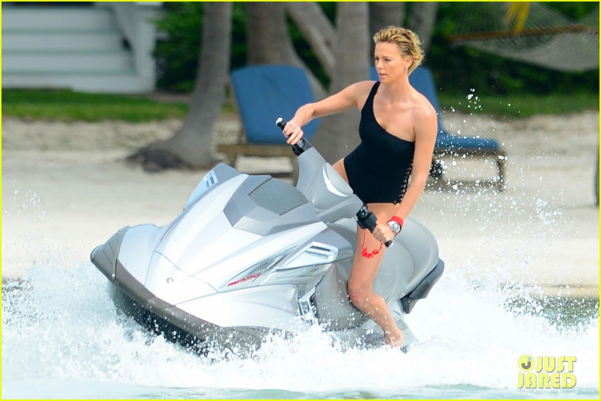 charlize therons bathing suit body is so enviable during jet ski shoot 083075473