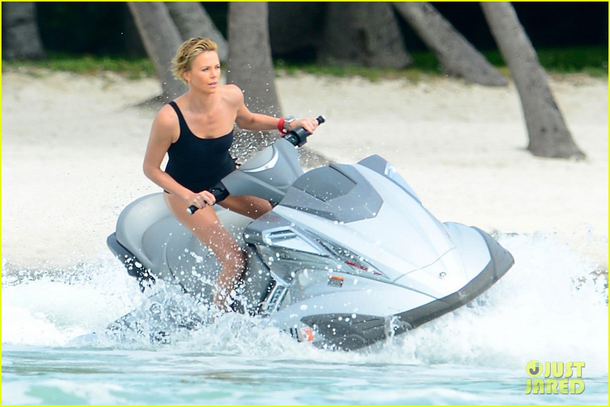 charlize therons bathing suit body is so enviable during jet ski shoot 093075474