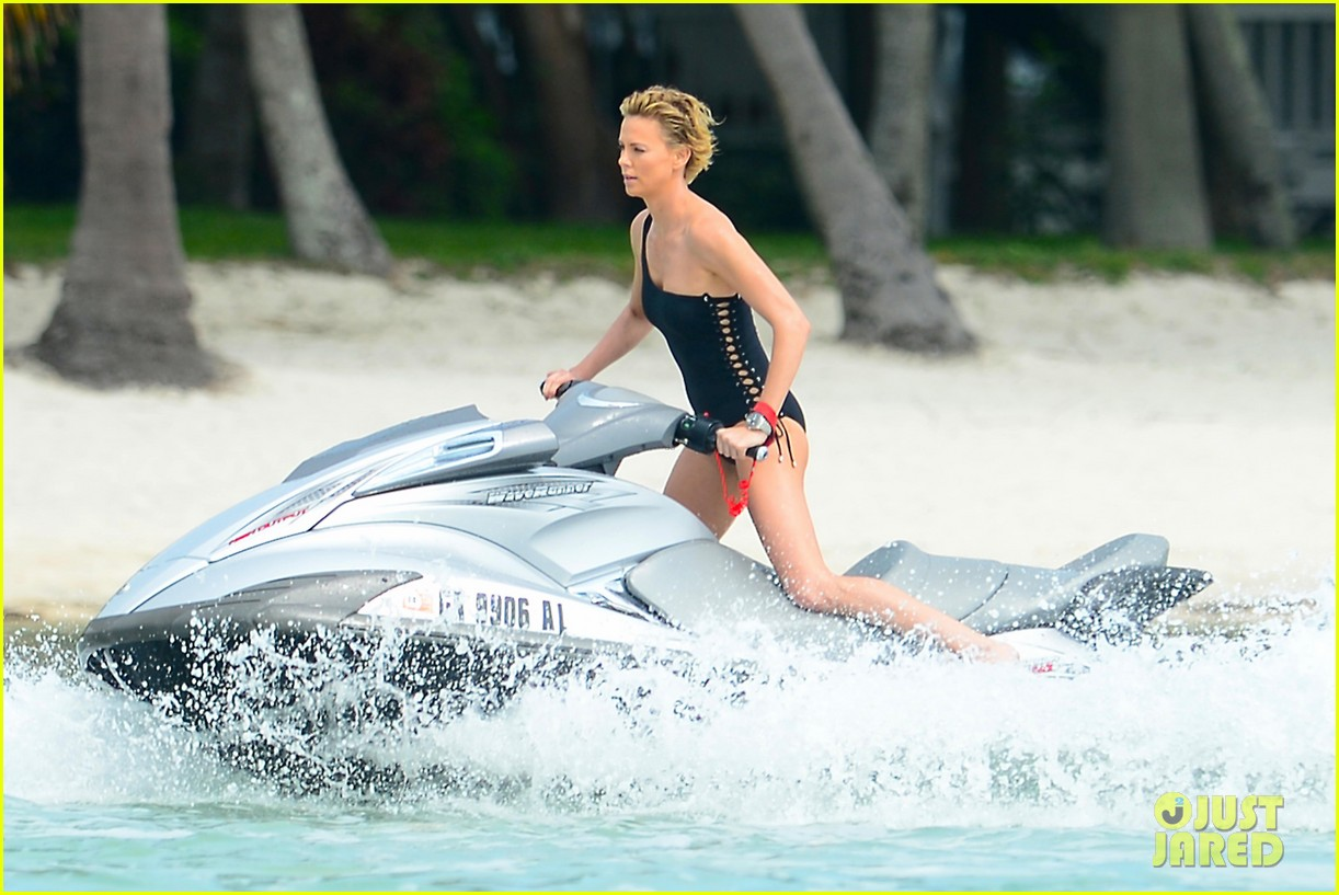 charlize therons bathing suit body is so enviable during jet ski shoot 113075476