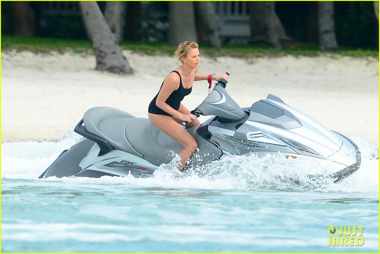 charlize therons bathing suit body is so enviable during jet ski shoot 123075477