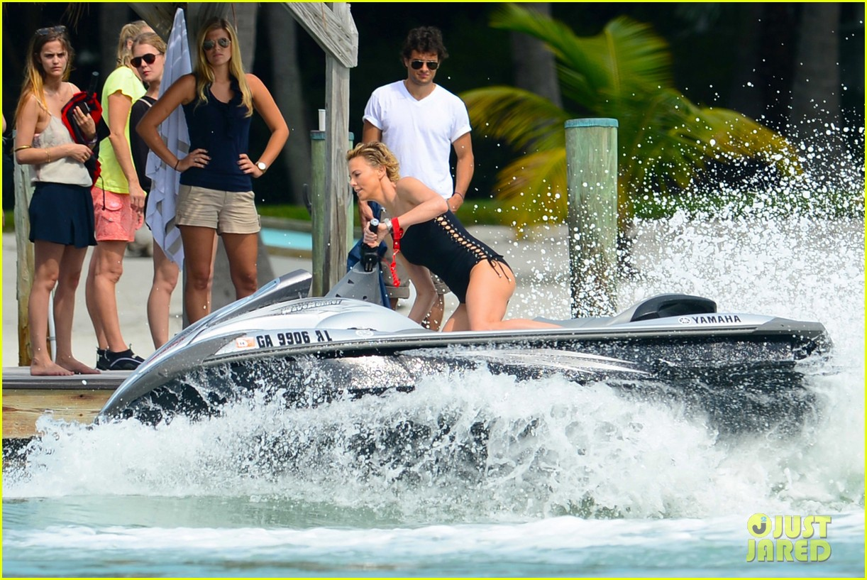 charlize therons bathing suit body is so enviable during jet ski shoot 13