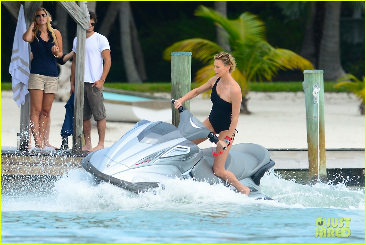 charlize therons bathing suit body is so enviable during jet ski shoot 143075479