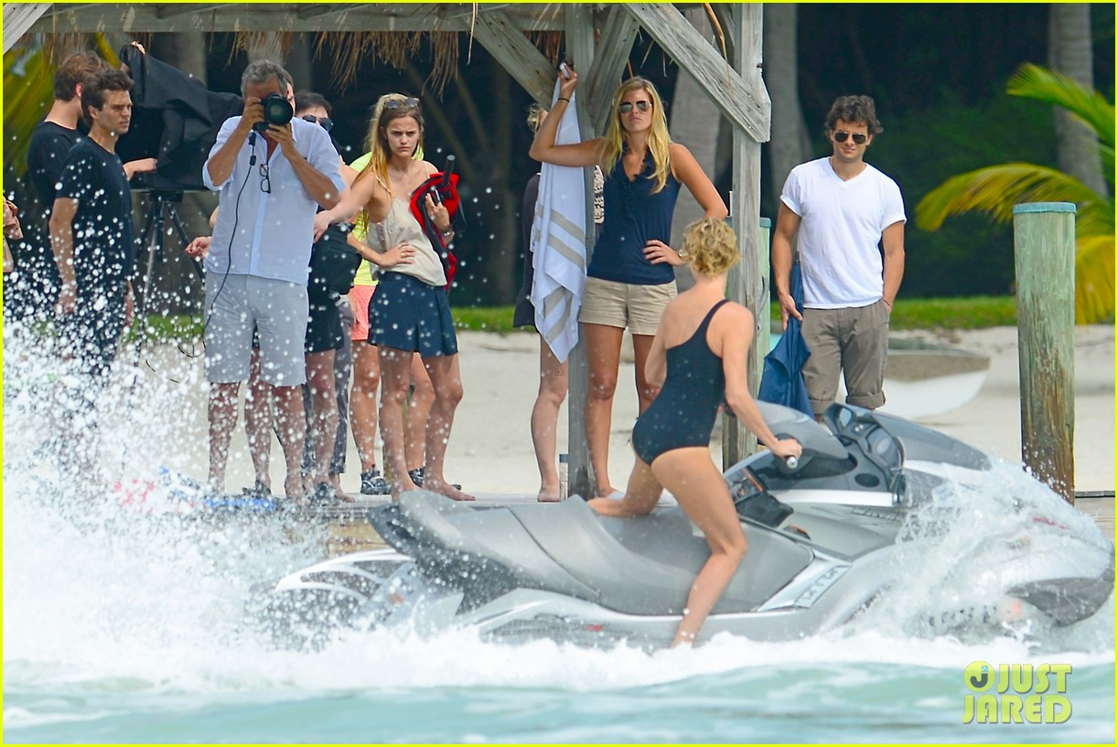 charlize therons bathing suit body is so enviable during jet ski shoot 153075480