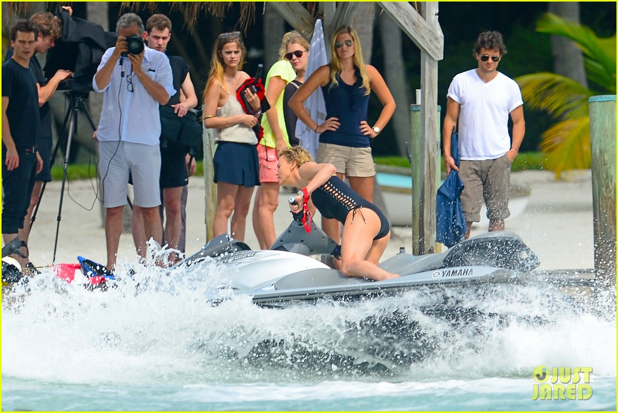charlize therons bathing suit body is so enviable during jet ski shoot 173075482