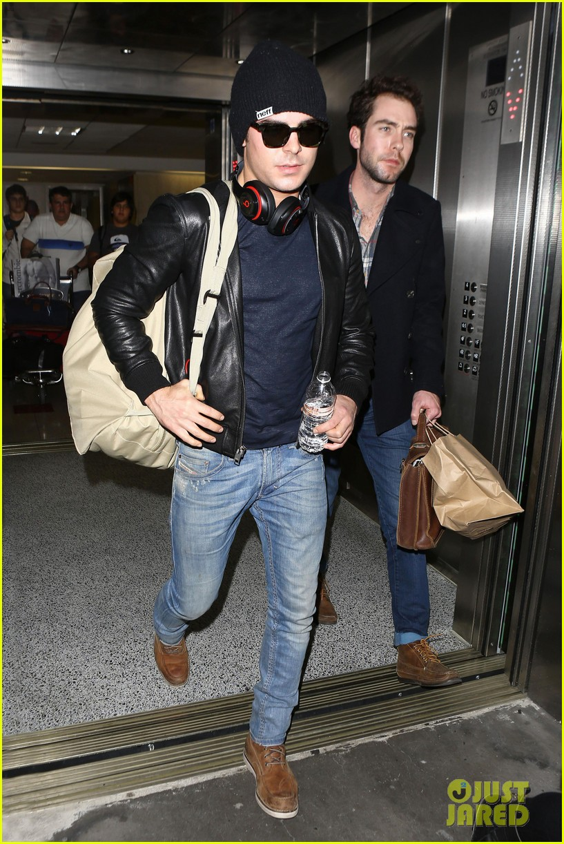 zac efron ashton kutcher fly out of austin after sxsw 063069200