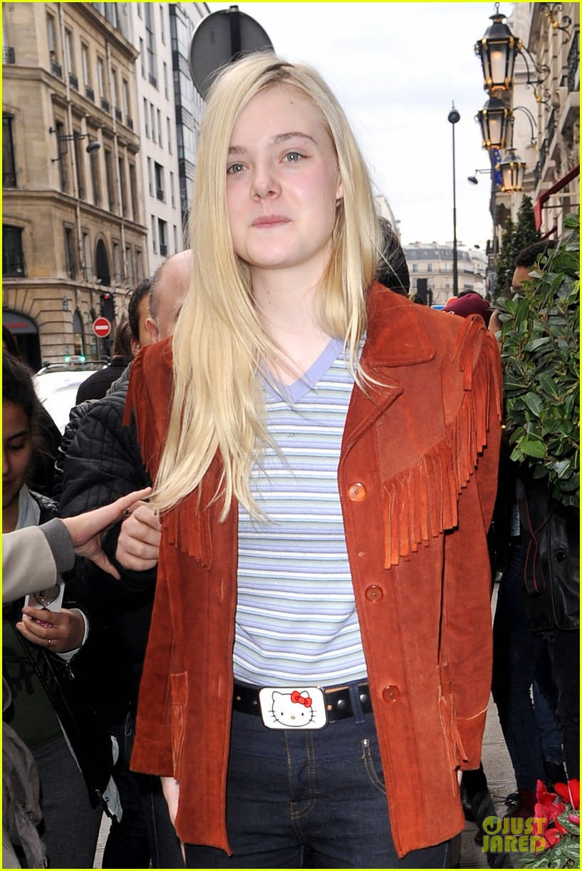 elle fanning makes a fringe fashion statement in france 083066104