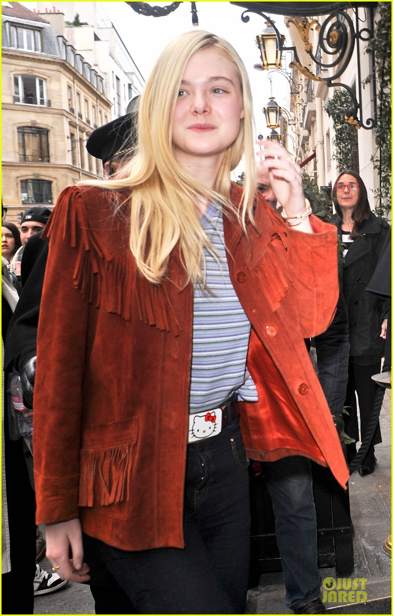 elle fanning makes a fringe fashion statement in france 093066105