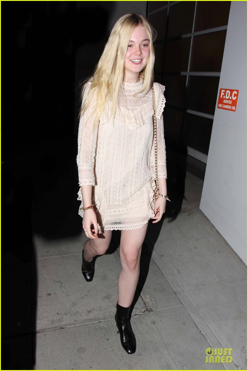 elle fanning teases the cameras in sheer dress at mr chow 013062660