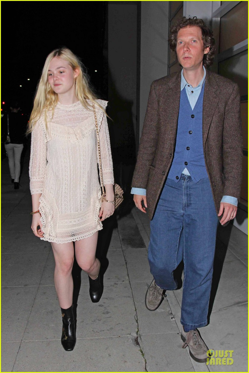 elle fanning teases the cameras in sheer dress at mr chow 093062668