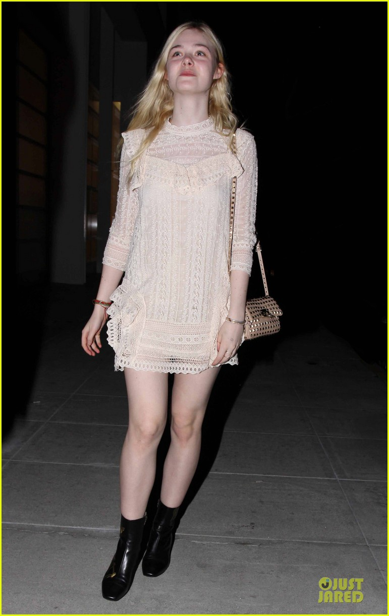 elle fanning teases the cameras in sheer dress at mr chow 103062669