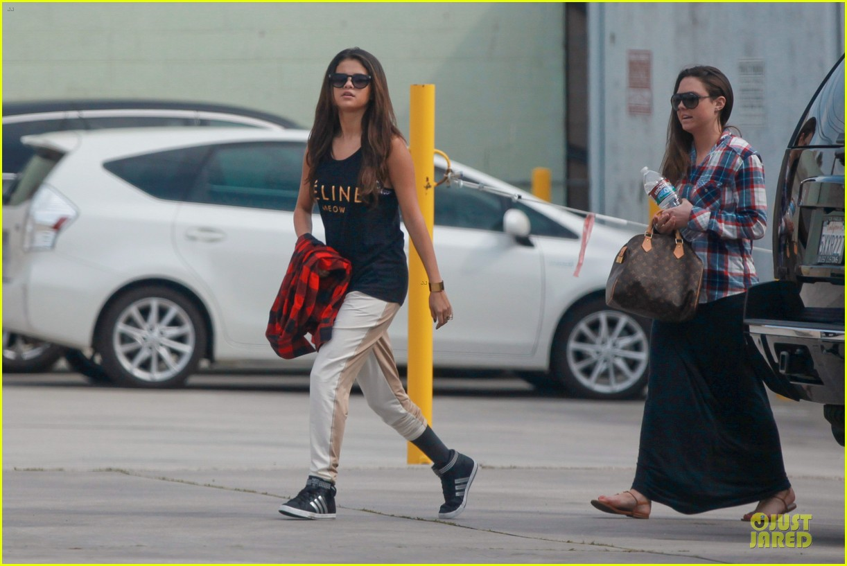 selena gomez is a meowing feline at a dance studio 07
