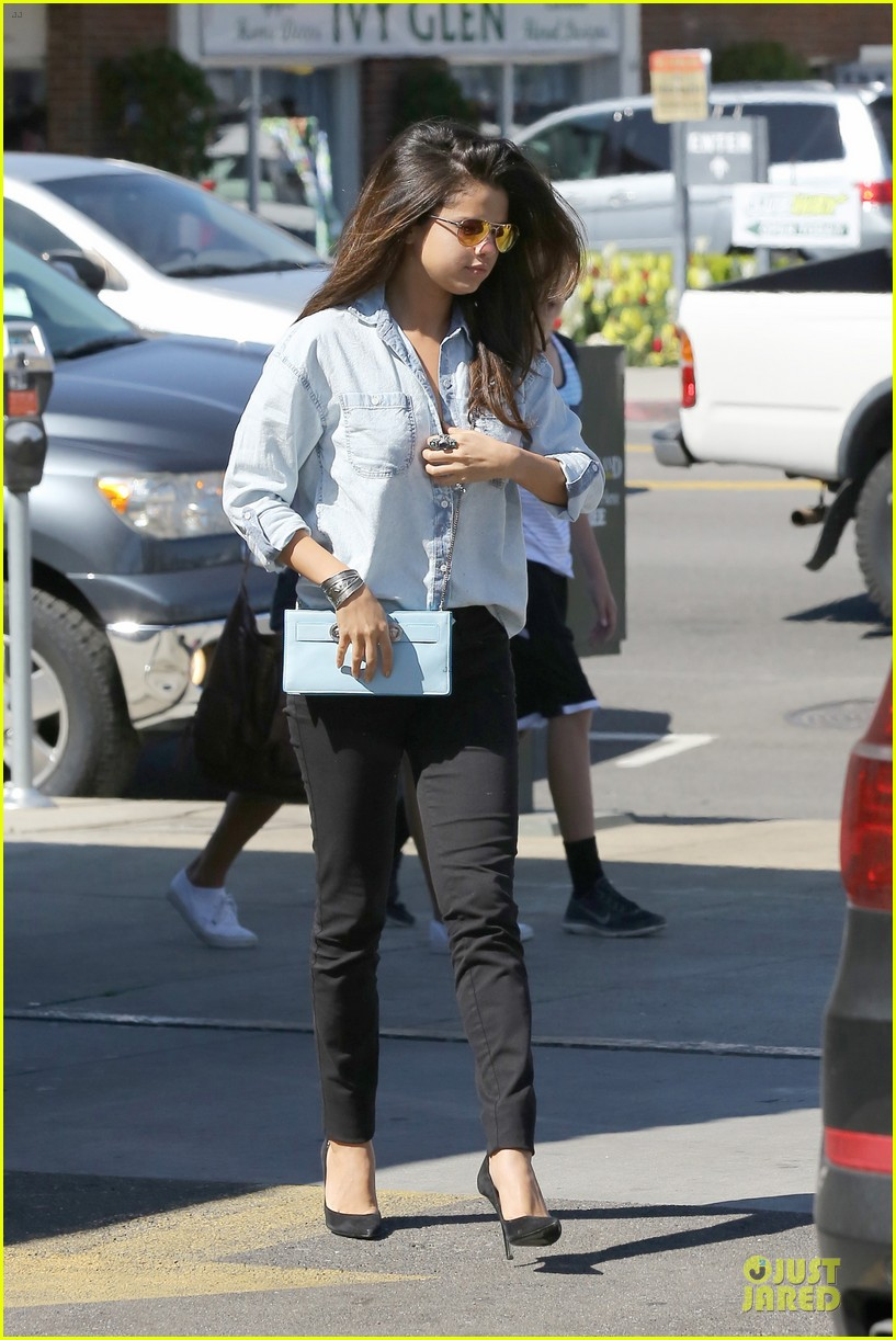 selena gomez teases us with low denim buttoned shirt 093072176