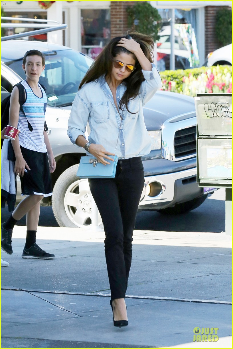 selena gomez teases us with low denim buttoned shirt 133072180