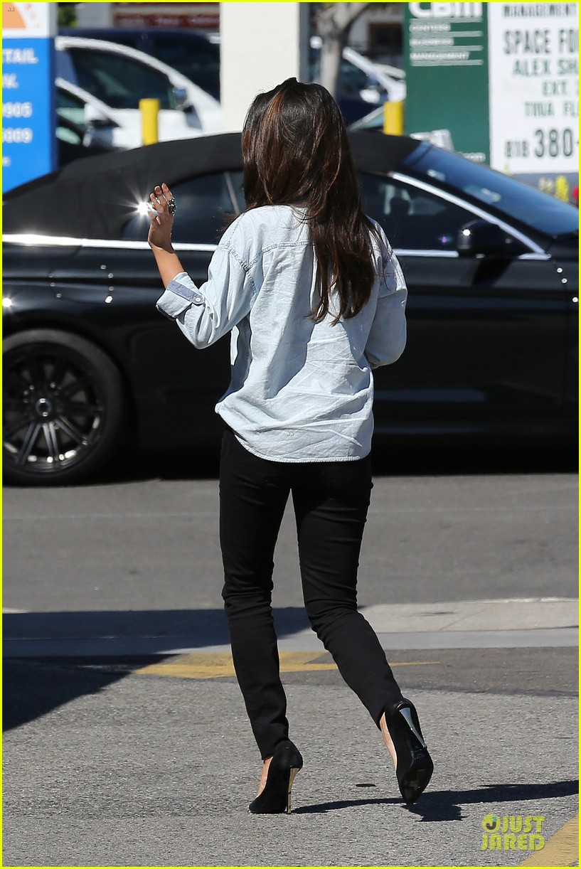 selena gomez teases us with low denim buttoned shirt 213072188