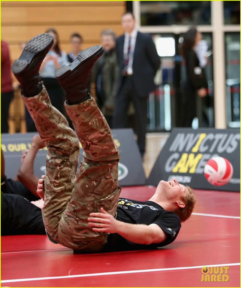 prince harry plays volleyball on the floor with injured soldiers 093067464