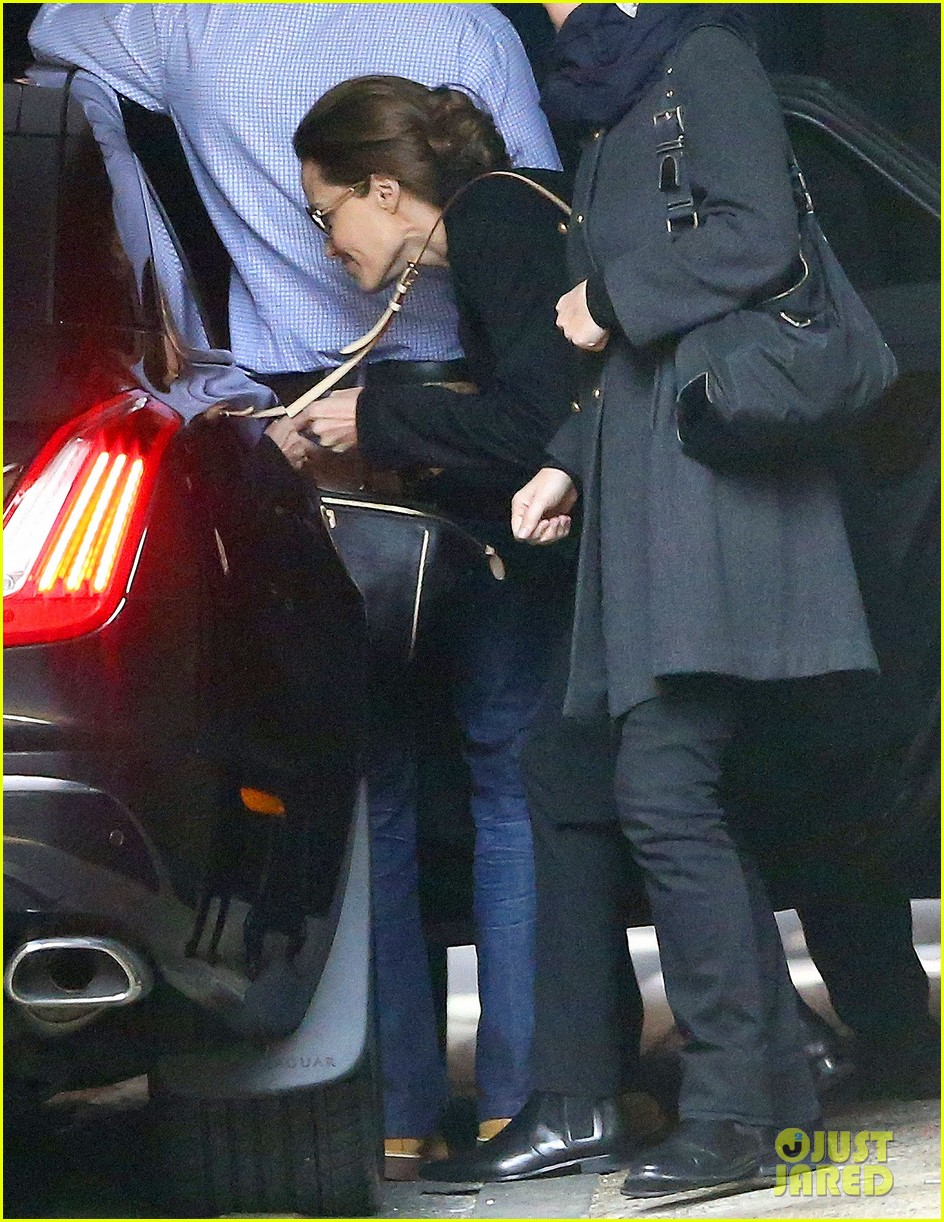 angelina jolie ducks into her car after quick london trip 043079727