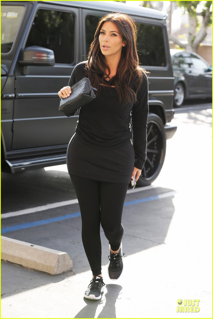 kim kardashian makes a very dark entrance at production office 063066132