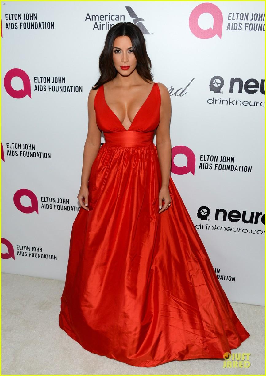 kim kardashian bares cleavage in red dress at elton john oscars party 2014 013064080