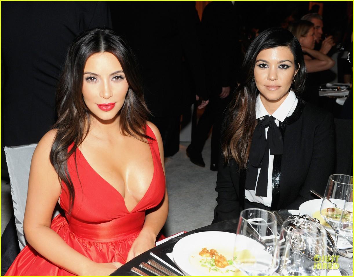 kim kardashian bares cleavage in red dress at elton john oscars party 2014 043064083