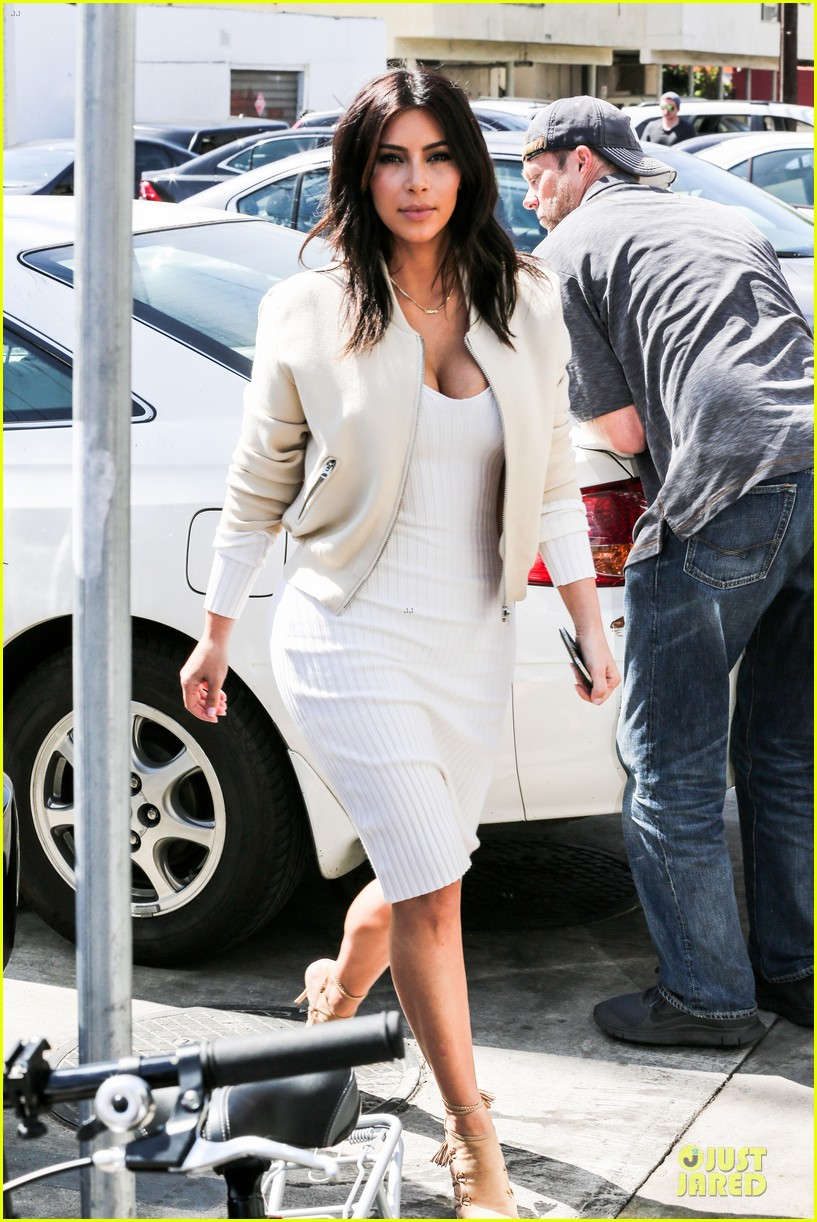 kim kardashian gets ready for summer with white dress 013072577