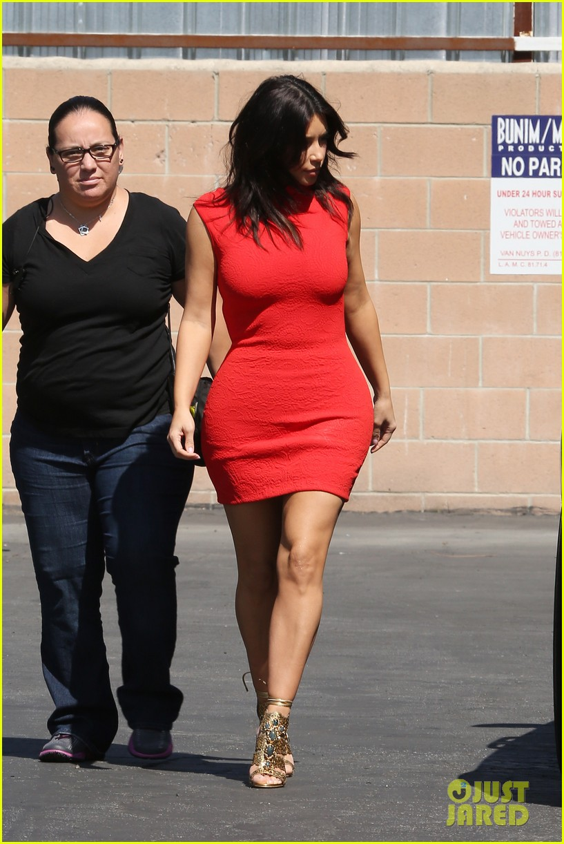 kim kardashian shows her figure in a tight little red dress 053072026
